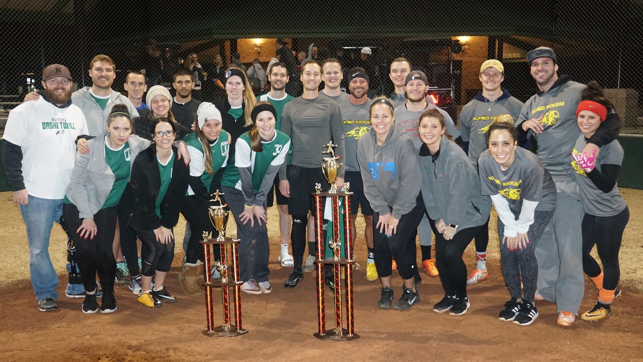 Two Kickball Teams with Trophies