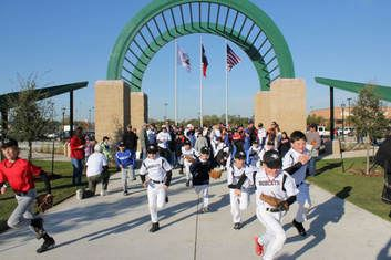 Baseball Players Running into Independence Park at the Grand Opening