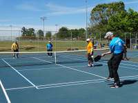 Four Older Citizens Playing Pickleball