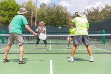 Four People Playing Pickleball