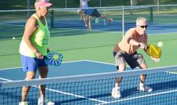 Older Man and Woman playing Pickleball