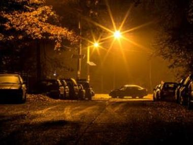 Cars Parked on a Street at Night