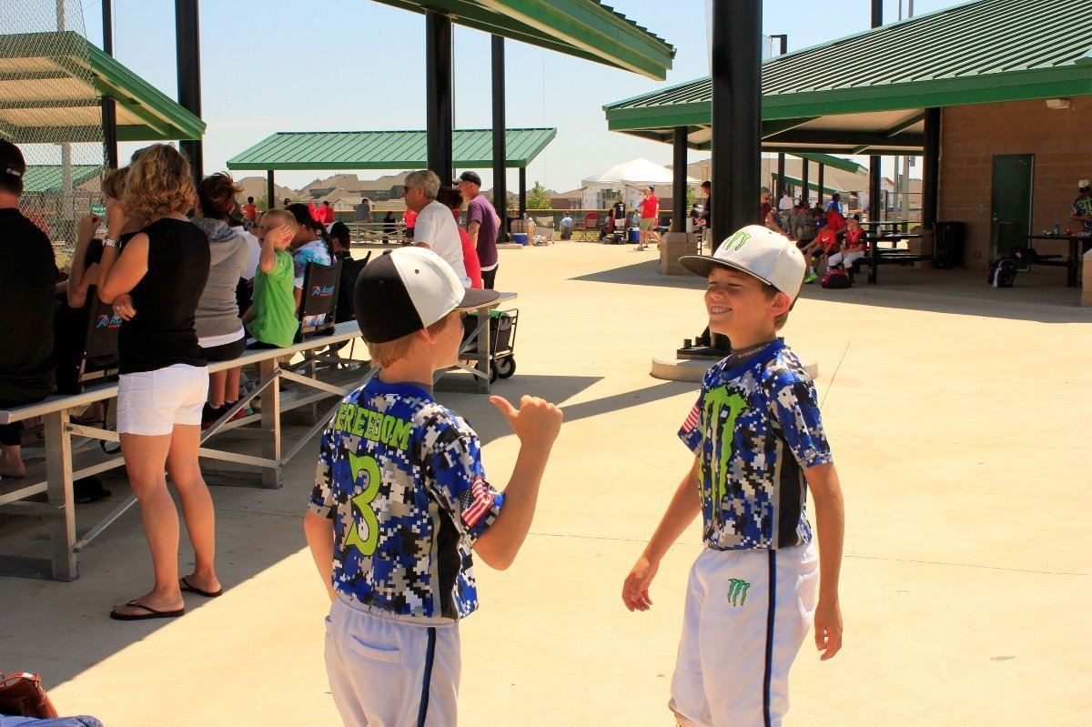 Two Boys at a Baseball Complex