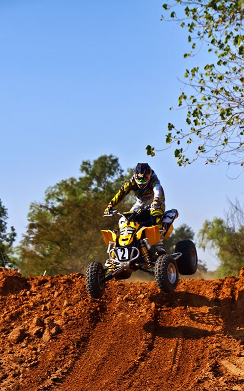 ATV Rider Going Over Hill