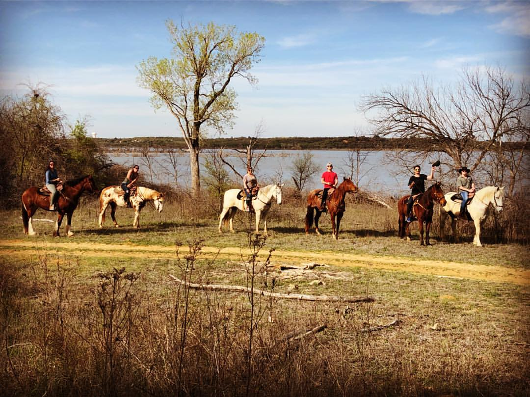Equestrian Riders At the Lake