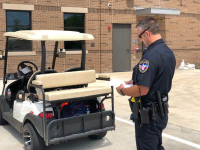 Police Officer Inspecting Golf Cart